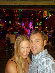 Me and my Partner on Bangla Road with a Pole dancer at work, visible from the street in the Go-go bar behind us