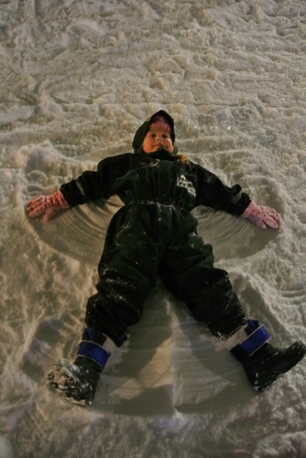 My Daughter making a Snow Angel for Santa outside his Log Cabin