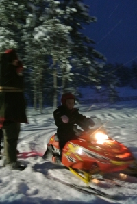 My 5 year old daughter driving a mini-skidoo