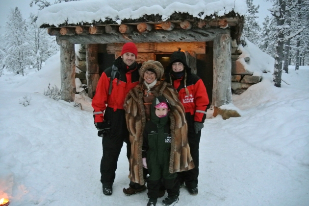My family and I, standingg with The Blacksmith Elf, outside her little cabin