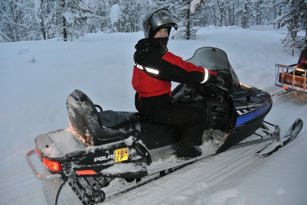 Me driving the Snowmobile through the Forest in Lapland near Saariselska