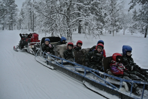 The children rode in a sleigh behind the Snowmobile leader.
