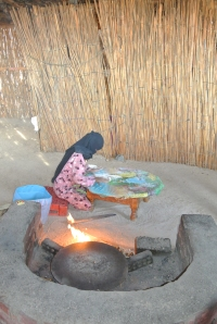 A Bedouin woman making flat bread