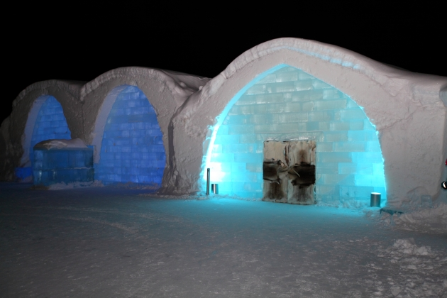 ICEHOTEL Sweden by night.  The darker blue arches on the left are UNIQUE ICEBAR